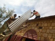 Corrugated metal sheets to repair roof