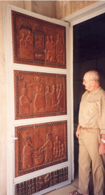 Pére Yves showing the carved door at Pel Catholic Mission